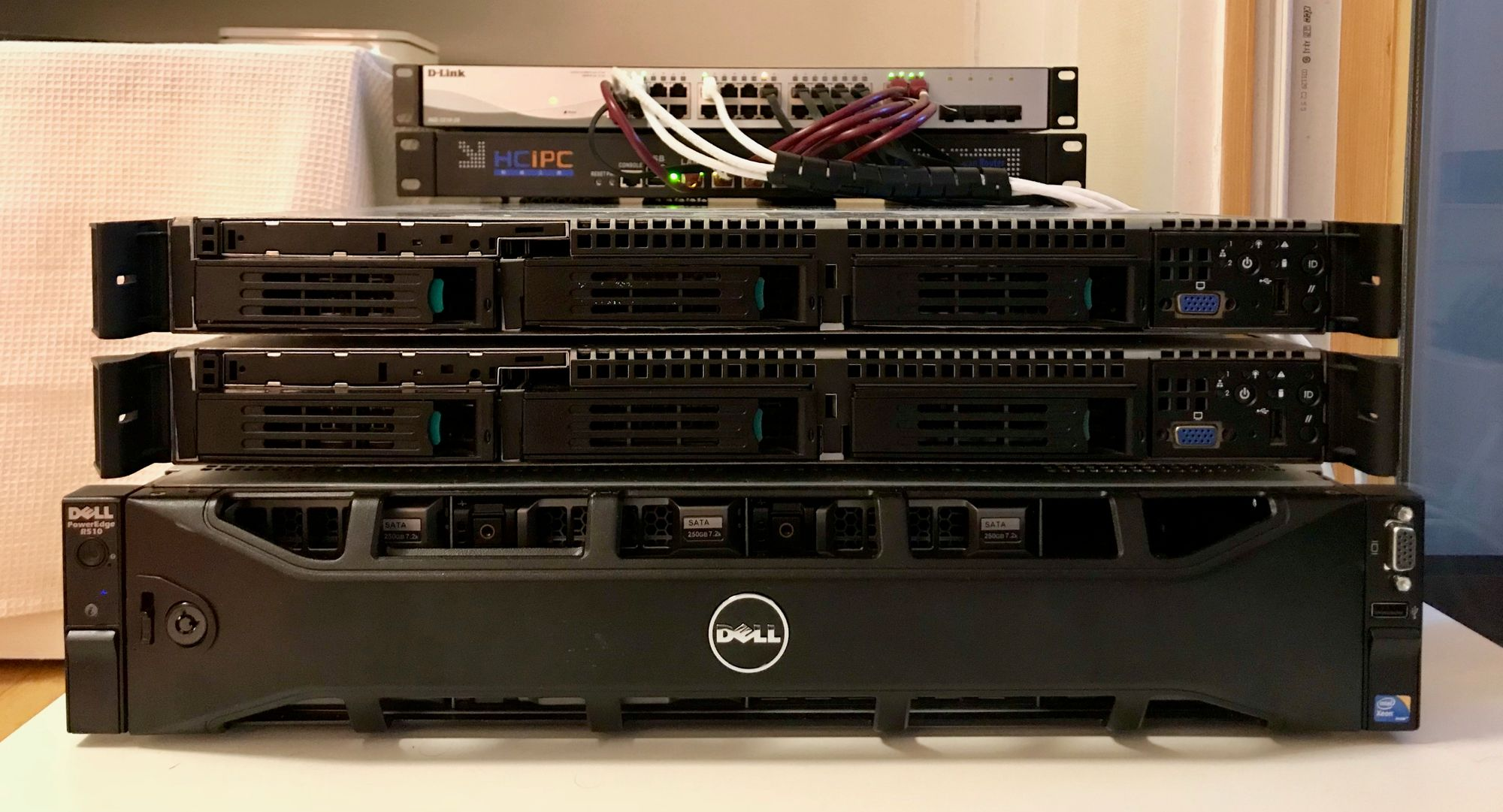 "Image showing my server stack; three servers, a ""custom"" router and switch."
