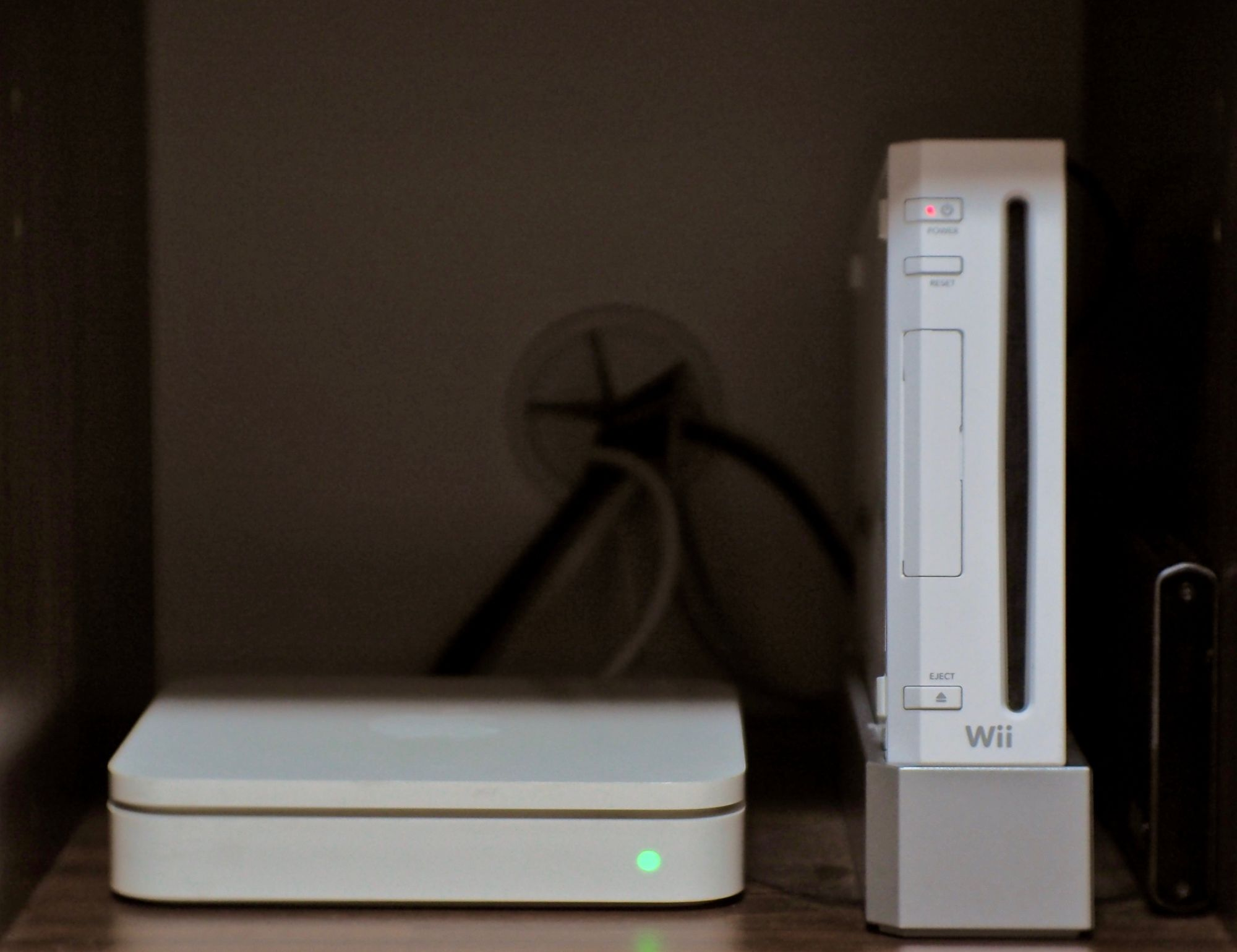 Image showing a Nintendo Wii standing next to an Apple Airport Extreme