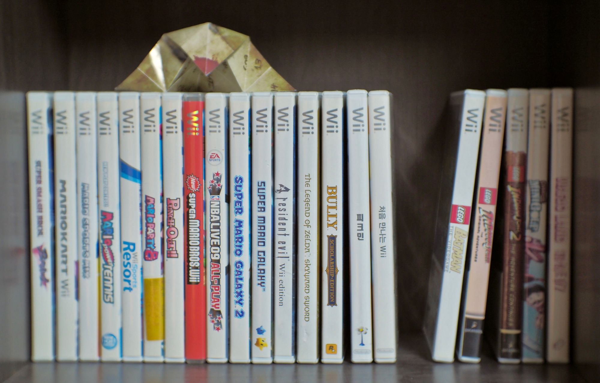 Image showing several Wii titles placed together in a bookcase.