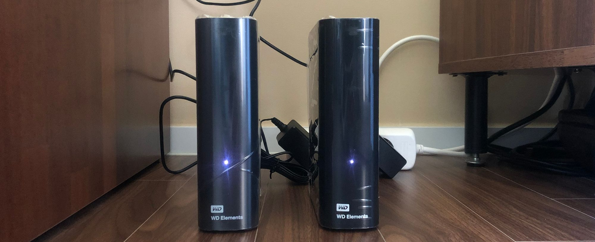 Two Western Digital Elements drives in their USB enclosures with activity lights blinking.